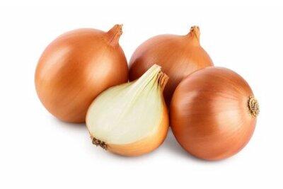 Naklejka yellow onion isolated on white background close up.