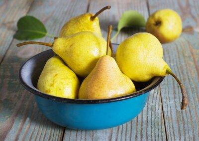 Naklejka yellow pear in a metal bowl