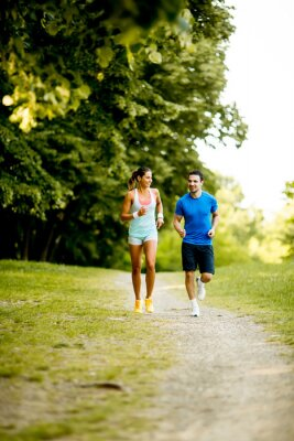 Naklejka Young couple running