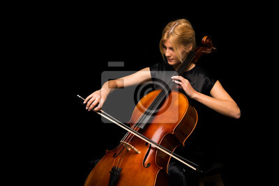 Naklejka Young girl playing the cello on isolated black background