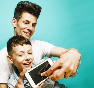 Naklejka young pretty man model with little cute son playing together, lifestyle modern people concept, family male