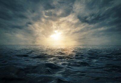 Naklejka Zachód słońca na wzburzonym morzu