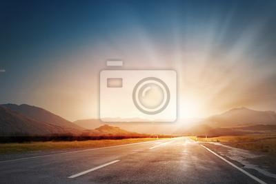 Naklejka Zachód słońca nad drogą