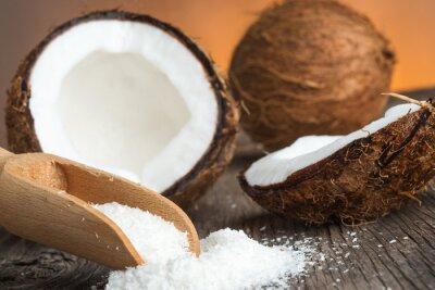 Naklejka Zamknij się z kokosem i płatkami kokosowymi uziemionych