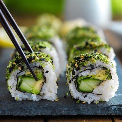 Naklejka zdrowa kapusta i awokado sushi pałeczkami