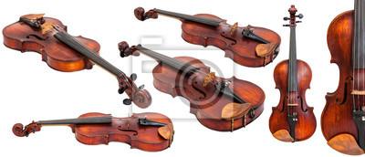 Naklejka Zestaw starych skrzypiec wyizolowanych na białym