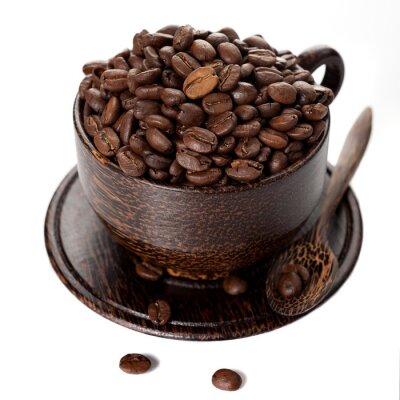 Naklejka Ziarna kawy w filiżance na białym tle