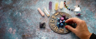 Naklejka zodiac horoscope symbol with fortune-teller hands and healing crystals on rustic background