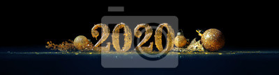 Obraz 2020 in sparkling gold numbers celebrating the New Year or Christmas with glittering ornaments and decorations