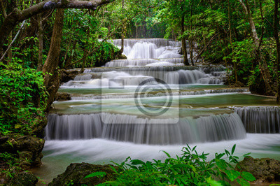 Obraz A beautiful waterfall deep in the tropical forest steep mountain adventure in the rainforest.
