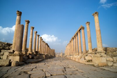 Obraz A view looking down the Cardo showing stone carved columns and paved street at the ancient city of Jarash or Gerasa, Jerash in Jordan. ancient Roman sights.