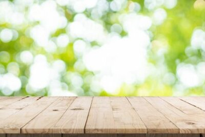 Obraz abstract blurred garden and green leaf with wooden table counter background for show , promote ,design on display concept