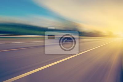 Obraz abstrakcyjne pusty asfaltu drogowego i rozmyte światła słonecznego w przestrzeni