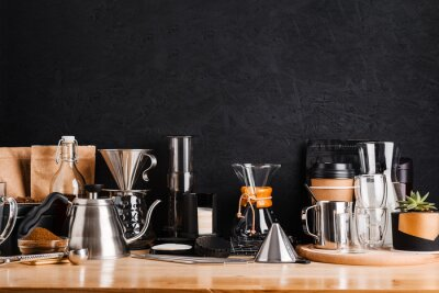 Obraz Accessories and utensils for making coffee drinks on a wooden table, coffee shop interior