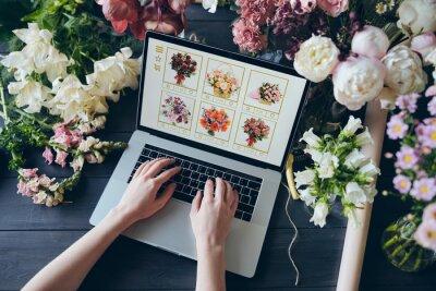 Obraz Adding flowers to cart on web wholesale store