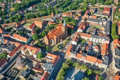 Obraz Aerial view of a Gothic church in a small town in Europe