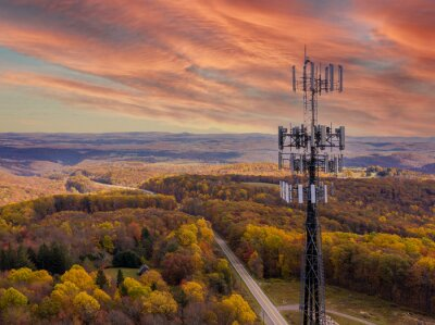 Obraz Aerial view of mobile phone cell tower over forested rural area of West Virginia to illustrate lack of broadband internet service