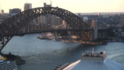 Aerial view of Sydney Harbor area at sunset from city rooftop