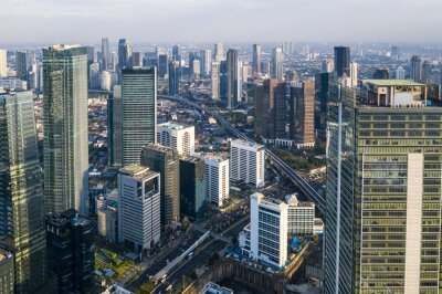 Aerial view of the modern Jakarta central business district along the Sudirman avenue with many corporate offices towers in Indonesia capital city