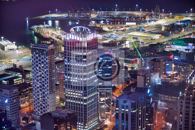 Amazing aerial view of Auckland skyline at night. City buildings and skyscrapers, New Zealand