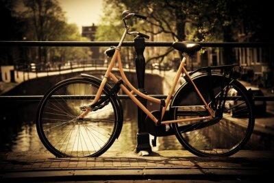 Obraz Amsterdam. Romantic canal bridge, bike