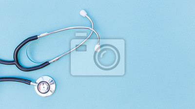 Obraz An elevated view of stethoscope over blue background