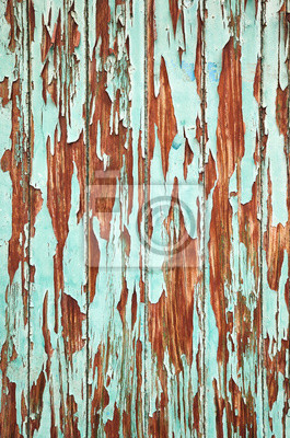 An old wooden wall with peeling paint, background or texture.