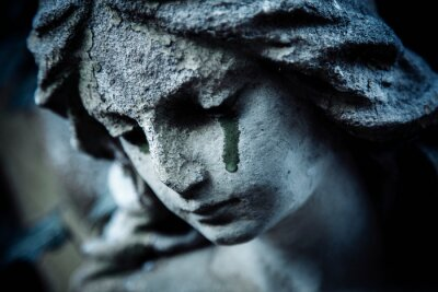Obraz Ancient stone statue of crying sad angel with tears in face as symbol of death and end of human life.