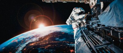 Obraz Astronaut spaceman do spacewalk while working for space station in outer space . Astronaut wear full spacesuit for space operation . Elements of this image furnished by NASA space astronaut photos.