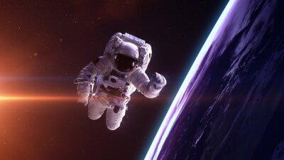Obraz Astronauta w przestrzeni kosmicznej. Elementy tego zdjęcia dostarczone przez NASA