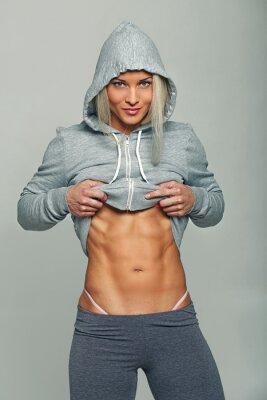 Obraz Athletic kobieta w szarym bluzy.