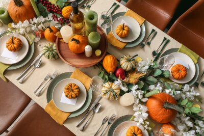 Obraz Autumn table setting with fresh pumpkins and flowers in room