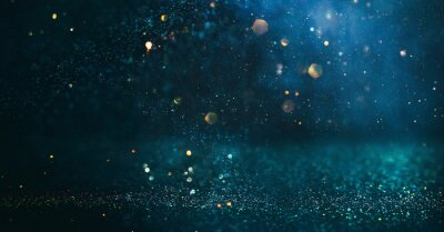 Obraz background of abstract glitter lights. gold, blue and black. de focused