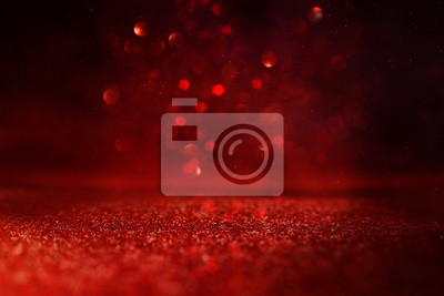 Obraz background of abstract red, gold and black glitter lights. defocused