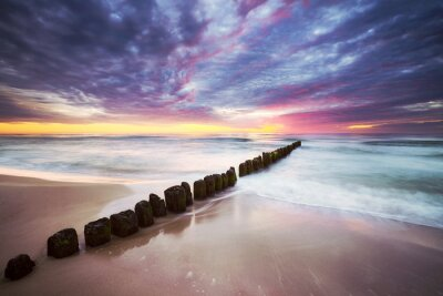 Baltic Sea coast in Mrzezyno at a beautiful sunset, long exposure picture, Poland.