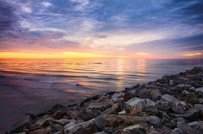 Baltic Sea rocky coast at sunset, Mrzezyno, Poland.
