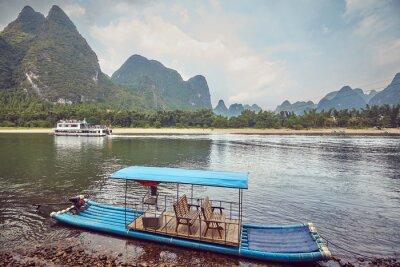 Bamboo like raft at Li River bank near Xingping, color toning applied, China.
