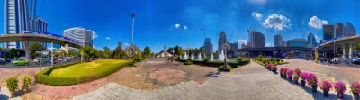BANGKOK, THAILAND - DECEMBER 16, 2019: City skyline on a beautiful day from the famous Lumphini Park. Panoramic view