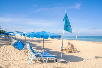 Beach with white sand and blue sea and sky in summer season