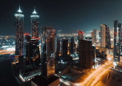 Obraz Beautiful Cityscape of a Modern Futuristic Buildings and Towers in the Lights of a Night City. Beauty of Luxury Life of Emirates. Dubai. United Arab Emirates.