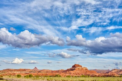 Beautiful cloudscape over rock formations in Canyonlands National Park, Utah, USA.