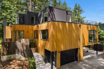 Obraz Beautiful exterior of modern home with linear design and elegant use of wood and metal, surrounded by trees on bright sunny day.