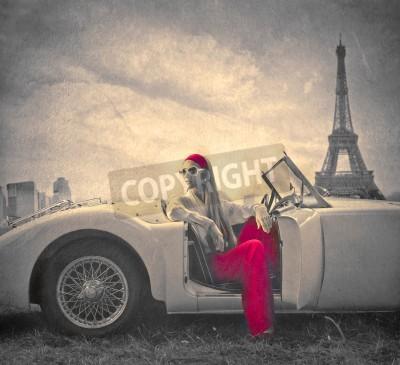 Obraz beautiful fashion woman on a car in Paris