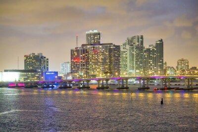 Beautiful illuminated bridge of Miami at night with city skyline