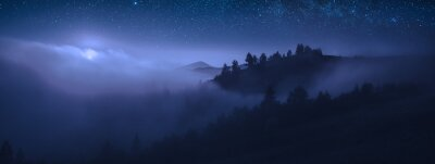 Obraz Beautiful moonrise over the foggy mountains at night
