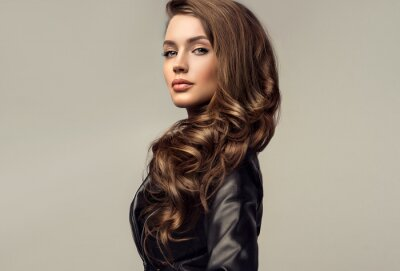 Obraz Beautiful stylish woman wearing  black leather jacket. Fashionable and self-confident girl with long curly hair. Clothing, style and fashion