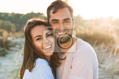 Obraz Beautiful young smiling couple spending time at the beach