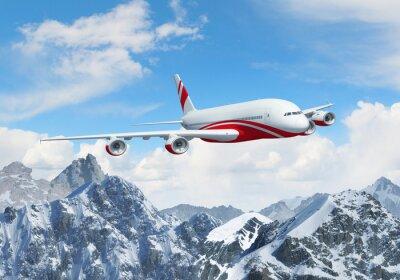 Obraz Biały samolot pasażerski nad górami