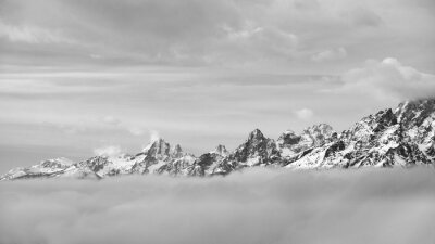 Black and white picture of Grand Teton mountain range in clouds, Wyoming, USA.