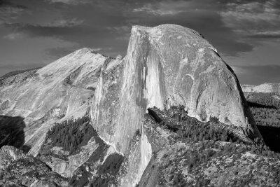 Black and white picture of Half Dome, famous granite dome of Yosemite Valley, California, USA.
